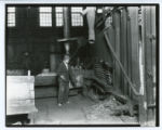 Uniformed worker at steel mill photograph