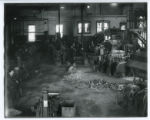 Workers in blacksmith shop