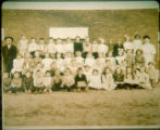 Class photograph infront of the east Swanton brick school