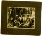 Photograph of Captain (Col.) Charles Young taken in 1903 with the Company of Buffalo Soldiers from...