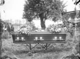 Closed casket with wreaths