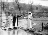 Women crossing stream photograph