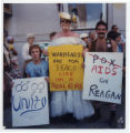 Three Protesters Holding Signs
