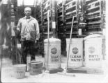 Janitor with mop and pail photograph