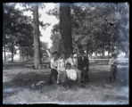 Girls around tree at fairgrounds picnic