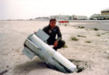 Rodger Cuccio with Propaganda Bomblet During First Gulf War Photograph