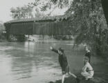 Covered bridge with children photograph