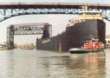 William G. Mather Steamship Being Towed to East Ninth Street Pier Photographs